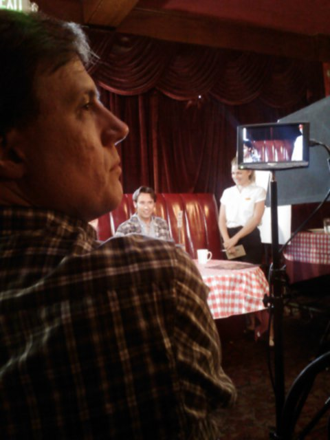"Julius directing ""All Things Chicken"" - Matt Mercer and Valerie Suter in the background - photo by Cherie Nelson"